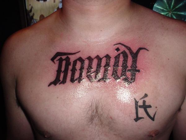 FAMILY FOREVER FAMILY SYMBOL TATTOO ON JOEYS CHEST in TATS IVE DONE by